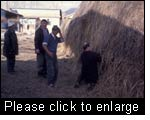 A farmer is surprised that the monitoring team assesses the quality of his hay so cautiously. Issyk Kul province, Kyrgyzstan.